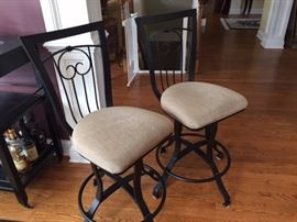 2 Counter-height, swivel chairs that go with kitchen table.