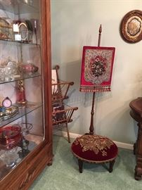 Picture of curio cabinet with glassware