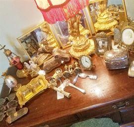 Opera glasses, antique and vintage glasses, cherub lamp, clocks