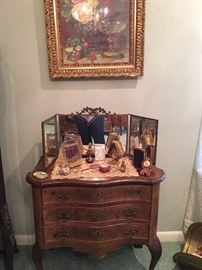 Small table with some Victorian accessories