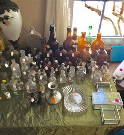 Beautiful glassware and antique medicine bottles