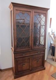 """Dark oak china cabinet with brass hardware, wood fretwork on glass doors, glass shelves and sides, lighted, 1 drawer, double door storage area with shelves.  42"""" W, 16"""" D, 76"""" T"""