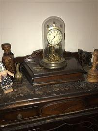 CLOCK ATOP ANTIQUE DRESSER