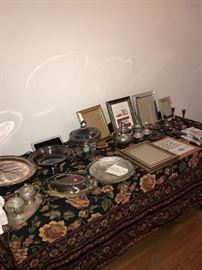 SILVER-PLATED TRAYS, TEAPOTS, CANDLE-HOLDERS AND PICTURE FRAMES