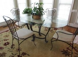 GLASS TOP TABLE IRON BASE AND CHAIRS 6' length and 4' across