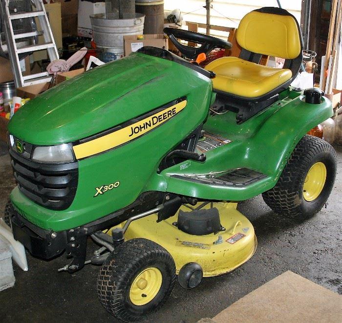 John Deer X300 Lawn Tractor w/Bagger (2613 Hrs.)