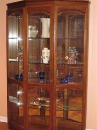 China cabinet. Mirror back with 4 glass shelves and in cabinet lighting W/2 keys