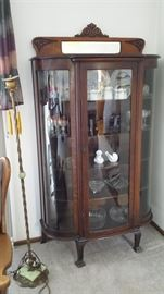 Antique curved front curio cabinet win clawfeet