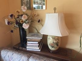 Books, sofa table, Asian-inspired lamps