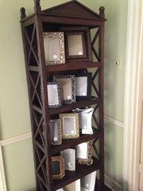 Five-tiered display cabinet filled with stunning frames