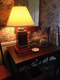 Asian lamp; antique entry table with drawer, flanked by a pair of Queen Anne chairs