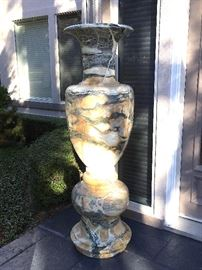 "Polished marble pair of vases on the front entry (67""Tx20""W).. WOW."