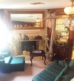 Sofa, arm chair with ottoman, side table, large mirror, statue of David, statue of Venus, desk, decorative items, candles, frames