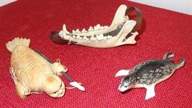 "(L) ""Spirit Walrus"" - Ladd Soonagrook; (R) Ring seal - Paul Apangaluk; (top) fox jaw sleigh"