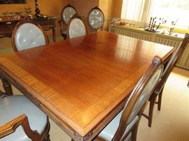 Table has multiple carved leaves