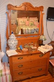 Beautiful American Oak Bedroom Set includes Bed with carved Headboard, Mirrored Dresser featuring beautiful carving and large Beveled Mirror plus Ox Bow Style Dry Sink notice here the small Leaded Glass Lamp, Perfumes, etc.