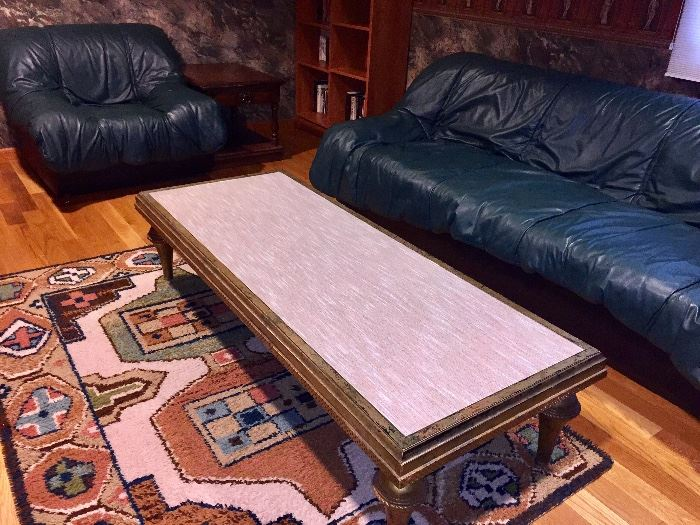 Funky glass top (fabric underneath the glass) coffee table with gold gilt wood.