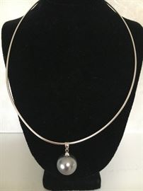 18K white gold fine snake chain with small diamond chip at clasp --- hanging on this chain is a Tahitian cultured pearl with certificate of authenticity. The pearl is a black lipped pinctada margaritefera.