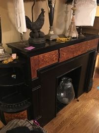 Beautiful Victorian fireplace mantle with side shelves and cabinets.