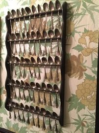Extensive collection of spoons on racks.  There are several to choose from.  Sold by rack or separately!