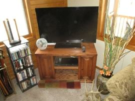 FLAT SCREEN TELEVISION AND STAND, MOVIES