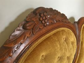 Detail of the grape carving on the sofa