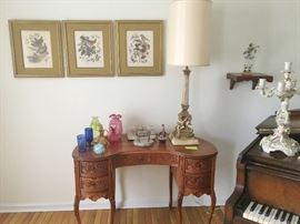 Beautiful carved kidney-shaped lady's desk. Vintage bird prints. Large cherub lamp. Vintage glass.
