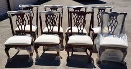 only 8 photographed but two dining tables and 16 total new ball and claw style chairs with white upholstry
