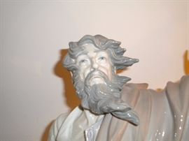 """01001811  MOSES & THE TEN COMMANDMENTS W/BOX Missing one finger Issue Year: 1996  Retirement Year: 2003  Sculptor: Salvador Furió Size: 21¼x11½ """"  Base included Limited Edition 1200 pieces. This piece records the moment when Moses is given the ten commandments of God on Mount Sinai. The prophet is portrayed as quite elderly. He holds the commandments in his hand, while at his feet is the burning bush which revealed to him the name of Jehovah, God of his parents, as well as his mission to lead his people from Egypt's oppression and to Canaan. Listed at Replacements 1799.00 no box, ebay listed 2500.00 no box."""