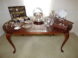 Queen Anne dining table, silverplate items