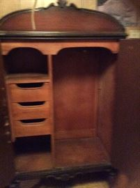 Inside of the vintage wardrobe armoire