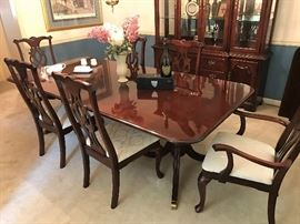 "Thomasville Banquet size 110"" includes both leaves. Cherry Dining Room table and 6 chairs.  Excellent Condition.  Thomasville China Cabinet."