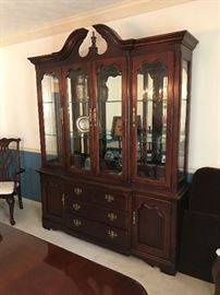 Thomasville cherry cabinet with beveled glass.