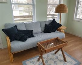 Wicker sofa, and mid century table lamp
