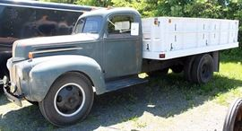 """At 7PM: 1946 Ford 2-ton Stake-Body Dump Truck with 30"""" Grain Sides; V8 Engine; 4-speed Transmission; 2-speed Rear Axle; Hydraulic Dump on 13.6' Bed."""