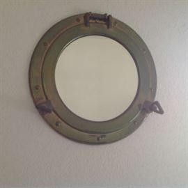 """Brass port hole mirror (about 16"""" wide) $ 40.00"""