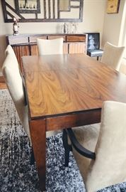 Beautiful rosewood dining table and buffet danish style, upholstered dining chairs with captain's chairs (Wall hangings and rug not included)