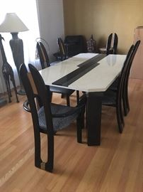 Dining room table & chairs, custom designed table will expand to seat 10 with 2 leaf inserts.  Black lacquered finish on table legs and chairs, with cheetah pattern