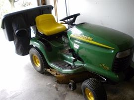 John Deere riding mower LT150 with accessories and pull behind trailer sold separately.
