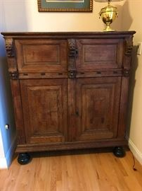 Antique Dutch Linen Cabinet with lions head carving.