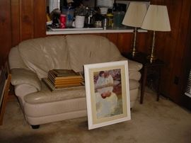 Nice leather sofa set, showing some of the many lamps, art, books and etc.