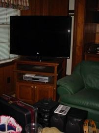 Another flat screen TV, stereo equipment, luggage and more