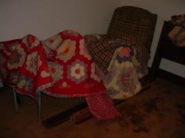 Several hand sewn vintage quilts