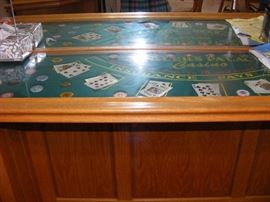 Black Jack Cabinet Has Eckler Name on the felt.  Light Oak, Lights, and mirror. Makes for a great bar Start Price $2200.00