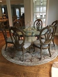 Gorgeous Glass Top Dining Table with 6 Leather Seat Chairs / Round Rug