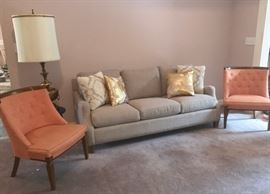 Like-new contemporary sofa embraced by a pair of retro side chairs, also in excellent condition