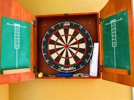 Hog hair dart board in cabinet w/darts.