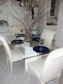 GLASS TOP TABLE WITH FOUR IVORY PARSONS CHAIRS