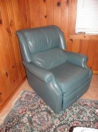 Aqua leather recliner, wool rug