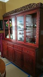 Asain China cabinet with carved details